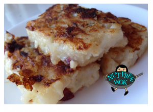 Hot and crispy daikon cake, yum! This batch was made with 100% diced daikon and you can see little chunks falling out of the cake, still delicious. :)