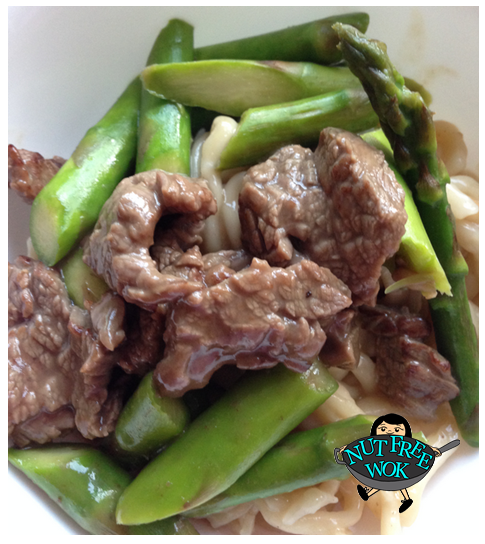Asparagus beef stir fry, served over udon noodles.