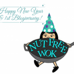 Nut Free Wok logo with a teal polka dotted party hat with a happy new year and first blogiversary