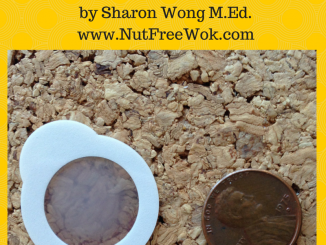photo of a peanut patch next to a penny to show their similar size