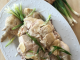 Bok Cheet Gai Slow Cooker Chinese White Cut Chicken on a white platter with some ginger, green onions, and sauce
