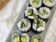 Easy and Allergy Friendly Cucumber and Avocado Sushi Rolls on a white rectangular serving dish