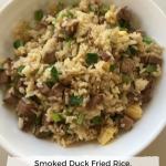 smoked duck fried rice in a white serving bowl