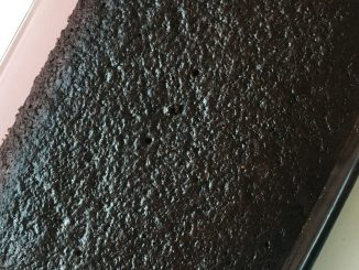 Classic Chocolate wacky cake baked in a 9x13 pan, looks very dark and chocolatey.