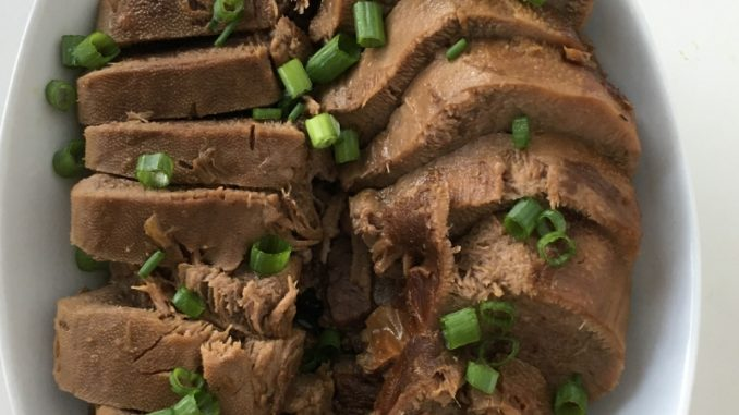 Instant Pot Beef Tongue, sliced, arranged, and ready to serve with a drizzle of soy-free soy sauce!