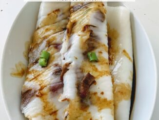 Char siu rice rolls plated in a white oval dish and drizzled with a sweet soy sauce