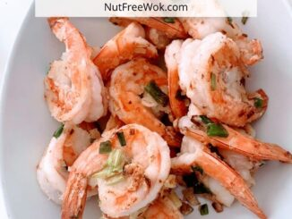 Stir fried shrimp in a white oval bowl